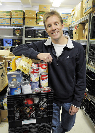 Mike Lutz, community service winner for Heart of Broomfield poses in the food sorting room at FISH of Broomfield.<br /> April 5, 2011<br /> staff photo/David R. Jennings