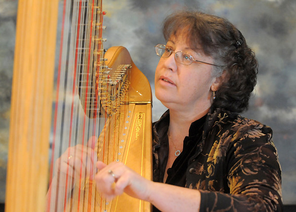 Nancy Brace Heart of Broomfield Arts winner plays her harp named Cassandra at the Rocky Mountain Center for Musical Arts in Lafayette.<br /> April 9, 2011<br /> staff photo/David R. Jennings