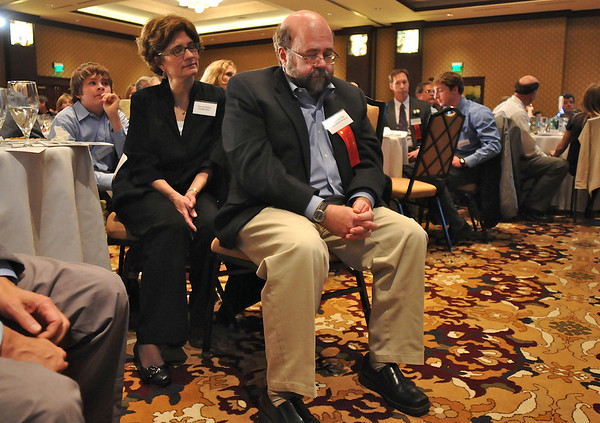 Kevin Standbridge, center, Gene Frank awrad, listens as he's beinging introduced at the Heart of Broomfield Awards ceremony with the Broomfield Community Foundation at the Omni Interlocken Resort Hotel on Monday.<br /> <br /> March 1, 2010<br /> Staff photo/David R. Jennings