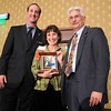 Colleen Sawyer , center, Arts Award with David Jurcak,  left,  Omni Interlocken Resort, and Clark Griep, president Broomfield Community Foundation, at the Heart of Broomfield Awards ceremony with the Broomfield Community Foundation at the Omni Interlocken Resort Hotel on Monday.<br /> <br /> March 1, 2010<br /> Staff photo/David R. Jennings