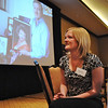 Ashley (Ahrens) Lind,listens to her father Randy Ahrens speak while accepting the Heart and Soul Award for the late Mary Jane Ahrens at the Heart of Broomfield Awards ceremony with the Broomfield Community Foundation at the Omni Interlocken Resort Hotel on Monday.<br /> <br /> March 1, 2010<br /> Staff photo/David R. Jennings