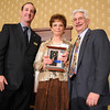 Karen Davis, center, Philanthropy Award with David Jurcak,  left,  Omni Interlocken Resort, and Clark Griep, president Broomfield Community Foundation, at the Heart of Broomfield Awards ceremony with the Broomfield Community Foundation at the Omni Interlocken Resort Hotel on Monday.<br /> <br /> March 1, 2010<br /> Staff photo/David R. Jennings