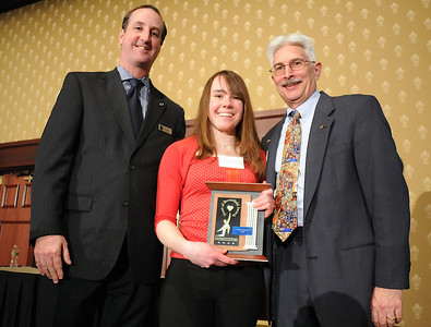 Melanie Ferraro, center, with the  xxx Award with David Jurcak,  left,  Omni Interlocken Resort, and Clark Griep, president Broomfield Community Foundation, at the Heart of Broomfield Awards ceremony with the Broomfield Community Foundation at the Omni Interlocken Resort Hotel on Monday.  March 1, 2010 Staff photo/David R. Jennings