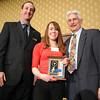 Melanie Ferraro, center, with the  xxx Award with David Jurcak,  left,  Omni Interlocken Resort, and Clark Griep, president Broomfield Community Foundation, at the Heart of Broomfield Awards ceremony with the Broomfield Community Foundation at the Omni Interlocken Resort Hotel on Monday.<br /> <br /> March 1, 2010<br /> Staff photo/David R. Jennings