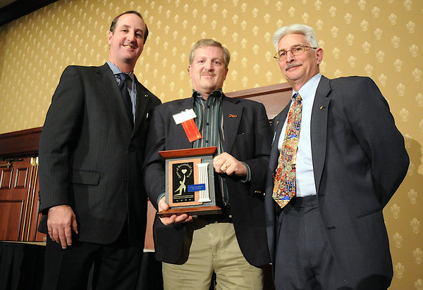 Randy Ahrens, center, accepting the Heart And Soul Award for his late wife Mary Jane Ahrens,  with David Jurcak,  left,  Omni Interlocken Resort, and Clark Griep, president Broomfield Community Foundation, at the Heart of Broomfield Awards ceremony with the Broomfield Community Foundation at the Omni Interlocken Resort Hotel on Monday.<br /> <br /> March 1, 2010<br /> Staff photo/David R. Jennings