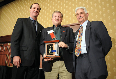Randy Ahrens, center, accepting the Heart And Soul Award for his late wife Mary Jane Ahrens,  with David Jurcak,  left,  Omni Interlocken Resort, and Clark Griep, president Broomfield Community Foundation, at the Heart of Broomfield Awards ceremony with the Broomfield Community Foundation at the Omni Interlocken Resort Hotel on Monday.  March 1, 2010 Staff photo/David R. Jennings