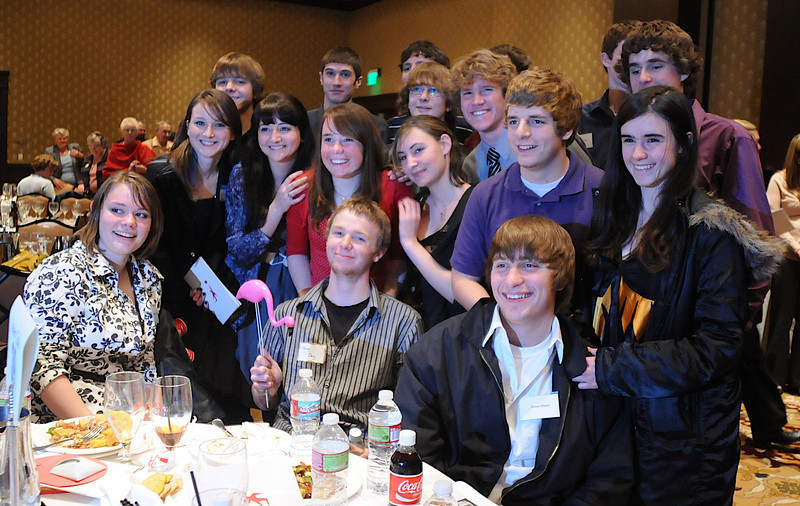 Students pose for pictures with Youth award winner Melanie Ferraro, center in red,  at the Heart of Broomfield Awards ceremony with the Broomfield Community Foundation at the Omni Interlocken Resort Hotel on Monday.<br /> <br /> March 1, 2010<br /> Staff photo/David R. Jennings