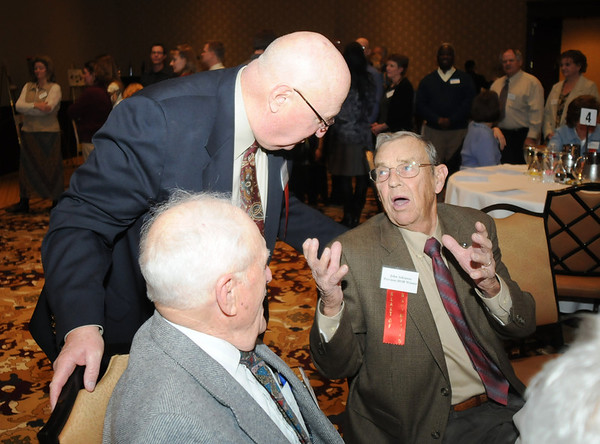Paul Derda, left, chats with John Atkinson at the Heart of Broomfield Awards ceremony with the Broomfield Community Foundation at the Omni Interlocken Resort Hotel on Monday.<br /> <br /> March 1, 2010<br /> Staff photo/David R. Jennings