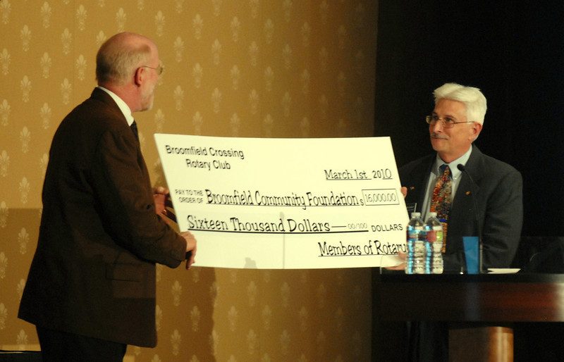 Ed Black, left, gives a check from the Rotary to Clark Griep, president of the Broomfeild Community Foundation, at the Heart of Broomfield Awards ceremony with the Broomfield Community Foundation at the Omni Interlocken Resort Hotel on Monday.<br /> <br /> March 1, 2010<br /> Staff photo/David R. Jennings
