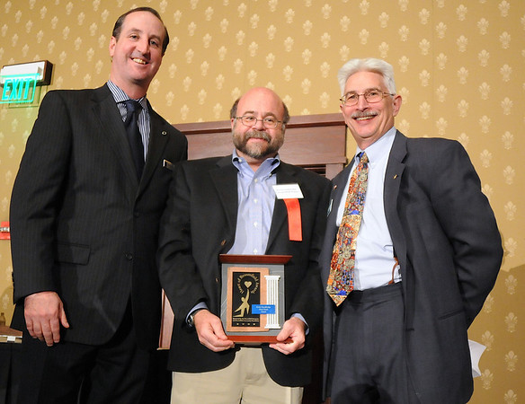 Kevin Standbridge, center, Gene Frank Award, with David Jurcak,  left,  Omni Interlocken Resort, and Clark Griep, president Broomfield Community Foundation, at the Heart of Broomfield Awards ceremony with the Broomfield Community Foundation at the Omni Interlocken Resort Hotel on Monday.<br /> <br /> March 1, 2010<br /> Staff photo/David R. Jennings