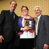 Liz Law-Evans , center, Community Service Award with David Jurcak,  left,  Omni Interlocken Resort, and Clark Griep, president Broomfield Community Foundation, at the Heart of Broomfield Awards ceremony with the Broomfield Community Foundation at the Omni Interlocken Resort Hotel on Monday.<br /> <br /> March 1, 2010<br /> Staff photo/David R. Jennings