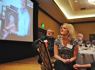 Ashley (Ahrens) Lind, right, and Randy Ahrens listen as the priases for the late Mary Jane Ahrens are read for the Heart and Soul Award at the Heart of Broomfield Awards ceremony with the Broomfield Community Foundation at the Omni Interlocken Resort Hotel on Monday.  March 1, 2010 Staff photo/David R. Jennings