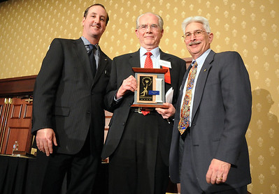 Roger T. Berg , center, Senior Award with David Jurcak,  left,  Omni Interlocken Resort, and Clark Griep, president Broomfield Community Foundation, at the Heart of Broomfield Awards ceremony with the Broomfield Community Foundation at the Omni Interlocken Resort Hotel on Monday.  March 1, 2010 Staff photo/David R. Jennings