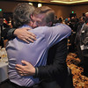 Randy Ahrens is hugged by frends a family memebeers after recieving the Heart and Soul Award for his wife Mary Jane Ahrens who died in January of caner at the Heart of Broomfield Awards ceremony with the Broomfield Community Foundation at the Omni Interlocken Resort Hotel on Monday.<br /> <br /> March 1, 2010<br /> Staff photo/David R. Jennings