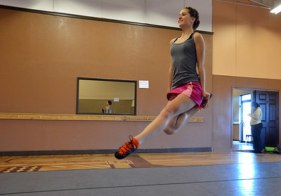 Meghan Doherty, 18, leaps while performing a dance during rehearsal at Taps 'n' Toes Dance Studio for the Heritage Irish Stepdancers performance at the Audi March 10th. March 2, 2013 staff photo/ David R. Jennings