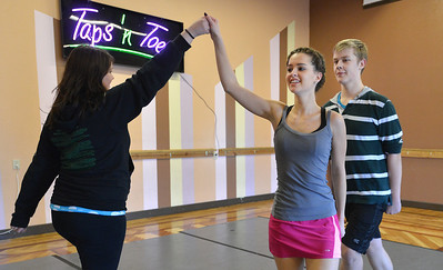 Meghan Doherty, 18, center, Jeff Decker, 16, right, and Kelseigh Fulton, 23, perform a dance during rehearsal at Taps 'n' Toes Dance Studio for the Heritage Irish Stepdancers performance at the Audi March 10th. March 2, 2013 staff photo/ David R. Jennings