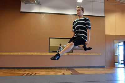 Jeff Decker, 16, leaps while performing a dance during rehearsal at Taps 'n' Toes Dance Studio for the Heritage Irish Stepdancers performance at the Audi March 10th. March 2, 2013 staff photo/ David R. Jennings