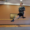 Jeff Decker, 16, leaps while performing a dance during rehearsal at Taps 'n' Toes Dance Studio for the Heritage Irish Stepdancers performance at the Audi March 10th.<br /> March 2, 2013<br /> staff photo/ David R. Jennings