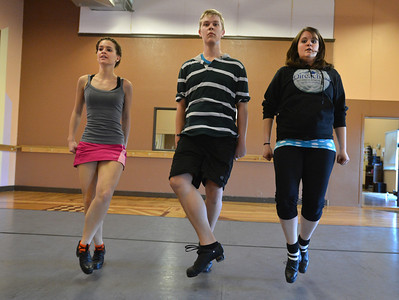 Meghan Doherty, 18, left, Jeff Decker, 16, and Kelseigh Fulton, 23, perform a dance during rehearsal at Taps 'n' Toes Dance Studio for the Heritage Irish Stepdancers performance at the Audi March 10th. March 2, 2013 staff photo/ David R. Jennings