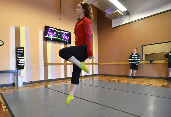 Morgan Pfeiffer, 16, performs a dance during rehearsal at Taps 'n' Toes Dance Studio for the Heritage Irish Stepdancers performance at the Audi March 10th.<br /> March 2, 2013<br /> staff photo/ David R. Jennings
