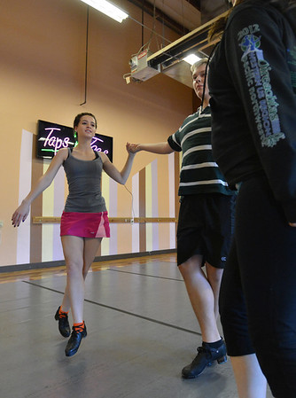 Meghan Doherty, 18, left, Jeff Decker, 16, and Kelseigh Fulton, 23, perform a dance during rehearsal at Taps 'n' Toes Dance Studio for the Heritage Irish Stepdancers performance at the Audi March 10th.<br /> March 2, 2013<br /> staff photo/ David R. Jennings