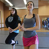Kelseigh Fulton, 23, left, performs a dance with Meghan Doherty, 18, during rehearsal at Taps 'n' Toes Dance Studio for the Heritage Irish Stepdancers performance at the Audi March 10th.<br /> March 2, 2013<br /> staff photo/ David R. Jennings