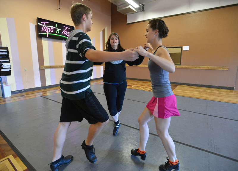 Jeff Decker, 16,  left, Kelseigh Fulton, 23, and Meghan Doherty, 18, perform a dance during rehearsal at Taps 'n' Toes Dance Studio for the Heritage Irish Stepdancers performance at the <br /> March 2, 2013<br /> staff photo/ David R. Jennings