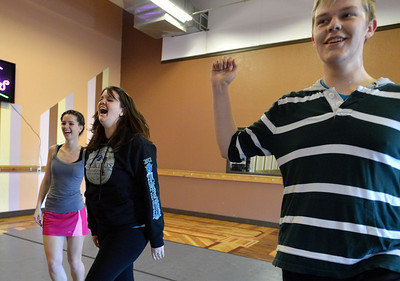 Meghan Doherty, 18, left, Kelseigh Fulton, 23, and Jeff Decker, 16, laugh while practicing a dance during rehearsal at Taps 'n' Toes Dance Studio for the Heritage Irish Stepdancers performance at the Audi March 10th. March 2, 2013 staff photo/ David R. Jennings