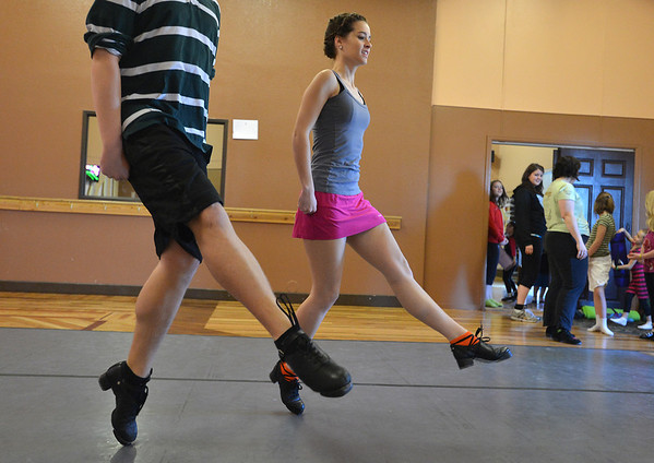 Jeff Decker, 16, left, dances with Meghan Doherty, 18, during rehearsal at Taps 'n' Toes Dance Studio for the Heritage Irish Stepdancers performance at the Audi March 10th.<br /> March 2, 2013<br /> staff photo/ David R. Jennings