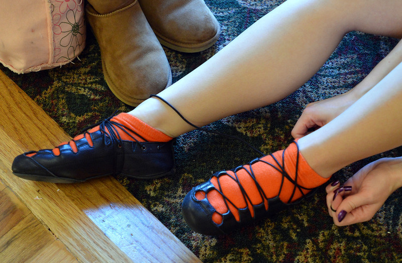 Meghan Doherty, 18, changes to her soft shoes for rehearsal at Taps 'n' Toes Dance Studio for the Heritage Irish Stepdancers performance at the Audi March 10th.<br /> March 2, 2013<br /> staff photo/ David R. Jennings