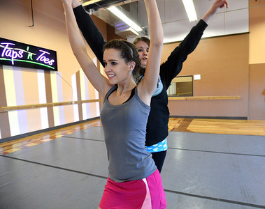 Kelseigh Fulton, 23, left, performs a dance with Meghan Doherty, 18, during rehearsal at Taps 'n' Toes Dance Studio for the Heritage Irish Stepdancers performance at the Audi March 10th. March 2, 2013 staff photo/ David R. Jennings