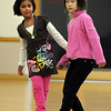Kareena Trivedi, 7 1/2, left, dances with Marisa Emoto, 8, during the 7-9 year old Hip Hop dance class on Wedensday at the Broomfield Community Center. <br /> <br /> January 06, 2010<br /> Staff photo/David R. Jennings