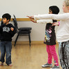Jayi Trivedi, 5, left, tries to follow dance moves with the class during the7-9 year old Hip Hop dance class on Wedensday at the Broomfield Community Center. <br /> <br /> January 06, 2010<br /> Staff photo/David R. Jennings