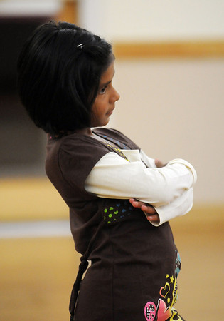 Kareena Trivedi, 7 1/2, stops and poses for the final move of a dance during the7-9 year old Hip Hop dance class on Wedensday at the Broomfield Community Center. <br /> <br /> January 06, 2010<br /> Staff photo/David R. Jennings