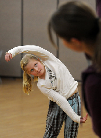 Macey LeVasseur, 8, learns how to move her arms from instructor Michelle hastings during the7-9 year old Hip Hop dance class on Wedensday at the Broomfield Community Center. The classes will continue for 12 weeks.<br /> <br /> January 06, 2010<br /> Staff photo/David R. Jennings