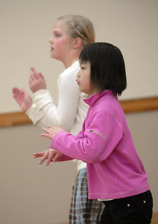 Marisa Emoto, 8, right, and Macey LeVasseur, 8, move their hands to the beat during the 7-9 year old Hip Hop dance class on Wedensday at the Broomfield Community Center. T<br /> <br /> January 06, 2010<br /> Staff photo/David R. Jennings