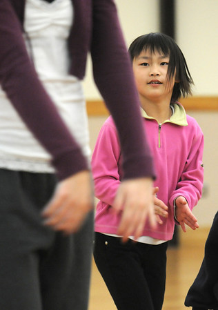 Marisa Emoto, 8, follows the moves of instructor Michelle Hastings during the 7-9 year old Hip Hop dance class on Wedensday at the Broomfield Community Center. <br /> <br /> January 06, 2010<br /> Staff photo/David R. Jennings