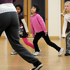 Kareena Trivedi, 7 1/2, left, Marisa Emoto, 8, and Macey LeVasseur, 8, watch instructor Michelle Hastings during the7-9 year old Hip Hop dance class on Wedensday at the Broomfield Community Center. <br /> <br /> January 06, 2010<br /> Staff photo/David R. Jennings