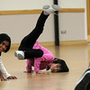 Dispite the snow Marisa Emoto, 8, center, and Kareena Trivedi, 7 1/2,  learn dance moves during the7-9 year old Hip Hop dance class on Wedensday at the Broomfield Community Center. <br /> <br /> January 06, 2010<br /> Staff photo/David R. Jennings