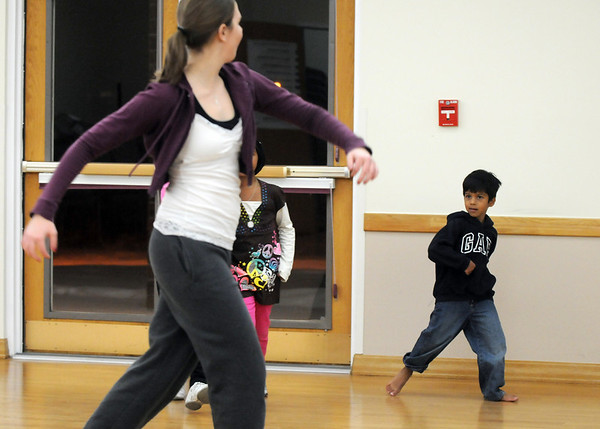 Jayi Trivedi, 7 1/2, right, watches instructor Michelle Hastings walk in style during the7-9 year old Hip Hop dance class on Wedensday at the Broomfield Community Center. <br /> <br /> January 06, 2010<br /> Staff photo/David R. Jennings