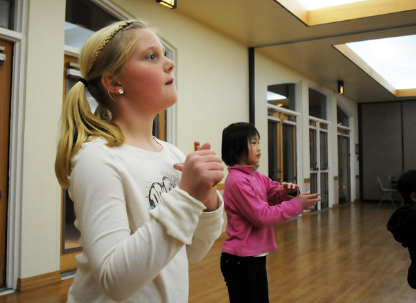 Macey LeVasseur, 8, left, and Marisa Emoto, 8, use their hands to follow the music during the7-9 year old Hip Hop dance class on Wedensday at the Broomfield Community Center. <br /> <br /> January 06, 2010<br /> Staff photo/David R. Jennings