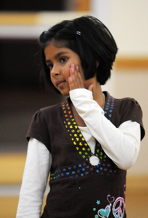 Kareena Trivedi, 7 1/2, uses her hand to move her head during the7-9 year old Hip Hop dance class on Wedensday at the Broomfield Community Center. <br /> <br /> January 06, 2010<br /> Staff photo/David R. Jennings