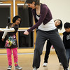 Instructor Michelle Hastings, center, demonstrates a move as Kareena Trivedi, 7 1/2, left, Marisa Emoto, 8, and Jayi Trivedi, 5, follow along during the7-9 year old Hip Hop dance class on Wedensday at the Broomfield Community Center. <br /> <br /> January 06, 2010<br /> Staff photo/David R. Jennings