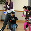 Jayi Trivedi, 5, center, walks in style with instructor Michelle Hastings, left, Marisa Emoto, 8, and Kareena Trivedi, 7 1/2, during the7-9 year old Hip Hop dance class on Wedensday at the Broomfield Community Center. <br /> <br /> January 06, 2010<br /> Staff photo/David R. Jennings