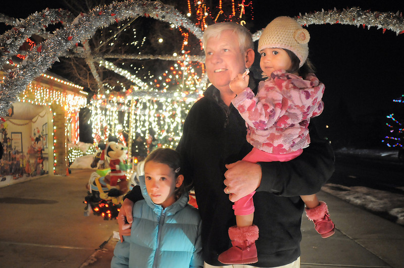 """Rick Jefferies with his grand daughters Avery Jefferies, 7, left, and Alia, 2, look at Kim Weibert's holiday lighting display at 1188 Clubhouse Drive.<br /> More photos please see  <a href=""""http://www.broomfieldenterprise.com"""">http://www.broomfieldenterprise.com</a><br /> December 9, 2011<br /> Staff photo/ David R. Jennings"""