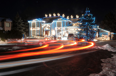Vehicle lights shine as people look at the holiday lighting display at 13941 Tincup Circle nicknamed the Christmas House. More photos please see www.broomfieldenterprise.com December 9, 2011 Staff photo/ David R. Jennings