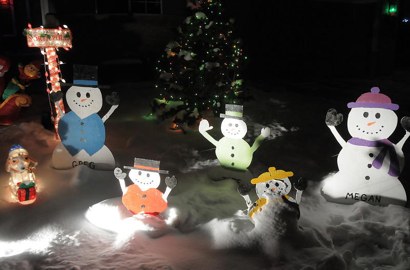 "The Holiday lighting display at 1130 Dover Way with happy snowmen.<br /> More photos please see  <a href=""http://www.broomfieldenterprise.com"">http://www.broomfieldenterprise.com</a><br /> December 8, 2011<br /> Staff photo/ David R. Jennings"