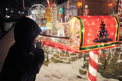 Zachery Dieke, 6, watches the animated mailbox in Kim Weibert's holiday lighting display at 1188 Clubhouse Drive. More photos please see www.broomfieldenterprise.com December 9, 2011 Staff photo/ David R. Jennings