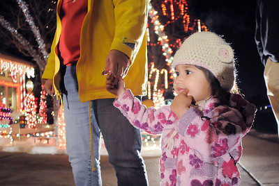 Alia Jefferies, 2, holds the hand of her grand mother Kathleen Jefferies while looking at Kim Weibert's holiday lighting display at 1188 Clubhouse Drive. More photos please see www.broomfieldenterprise.com December 9, 2011 Staff photo/ David R. Jennings