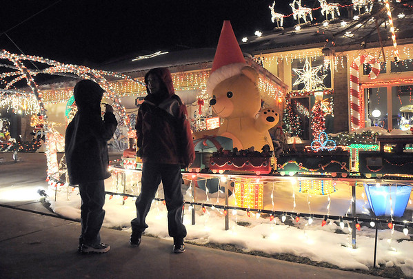 "Brothers Zachery, 6,  and Camerin Dieke, 9, look at Kim Weibert's holiday lighting display at 1188 Clubhouse Drive.<br /> More photos please see  <a href=""http://www.broomfieldenterprise.com"">http://www.broomfieldenterprise.com</a><br /> December 9, 2011<br /> Staff photo/ David R. Jennings"